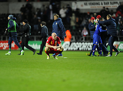 James Collins (West Ham United) of Wales cuts a dejected figure on the final whistle as Croatia celebrate in the background - Photo mandatory by-line: Joe Meredith/JMP - Tel: Mobile: 07966 386802 26/03/2013 - SPORT - FOOTBALL -  Liberty Stadium - Swansea -  Wales V Croatia - WORLD CUP QUALIFIER