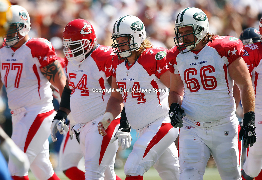 HONOLULU, HI - FEBRUARY 08: AFC All-Stars Alan Faneca #66 of the New York Jets and Nick Mangold #74 of the New York Jets lead the offensive front to the line of scrimmage during the game against the NFC All-Stars in the 2009 NFL Pro Bowl at Aloha Stadium on February 8, 2009 in Honolulu, Hawaii. The NFC defeated the AFC 30-21. ©Paul Anthony Spinelli *** Local Caption *** Alan Faneca;Nick Mangold