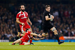 New Zealand Flanker Richie McCaw (capt) is tackled by Georgia replacement Vasil Lobzhanidze - Mandatory byline: Rogan Thomson/JMP - 07966 386802 - 02/10/2015 - RUGBY UNION - Millennium Stadium - Cardiff, Wales - New Zealand v Georgia - Rugby World Cup 2015 Pool C.