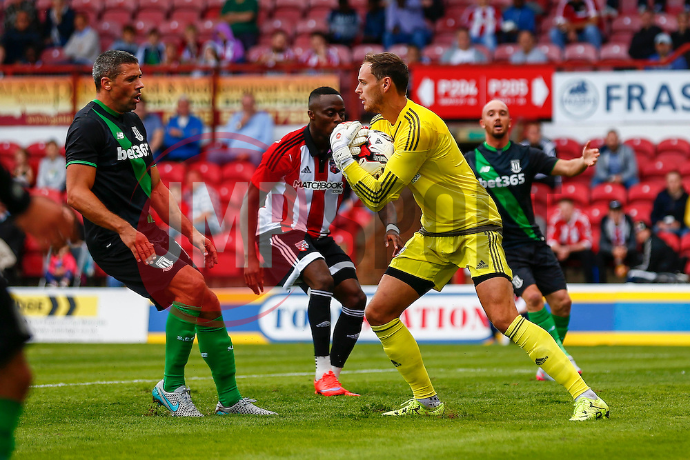 David Button of Brentford comes out to save a cross from Bojan Krkic of Stoke City - Mandatory by-line: Jason Brown/JMP - Mobile 07966 386802 25/07/2015 - SPORT - FOOTBALL - Brentford, Griffin Park - Brentford v Stoke City - Pre-Season Friendly