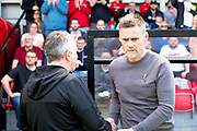 managers shaking hands  during the EFL Sky Bet League 2 match between Salford City and Port Vale at Moor Lane, Salford, United Kingdom on 17 August 2019.