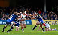 Dragons Flanker (#7) Nic Cudd is tackled by Bath Lock (#4) Stuart Hooper (Capt) during the first half of the match - Photo mandatory by-line: Rogan Thomson/JMP - Tel: Mobile: 07966 386802 09/11/2012 - SPORT - RUGBY - The Recreation Ground - Bath. Bath v Newport Gwent Dragons  - LV= Cup