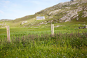 Small boffey building in rocky setting, at Allathasdal, Barra, Outer Hebrides, Scotland, UK