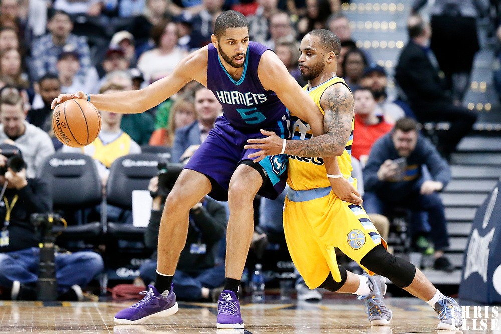 04 March 2017: Charlotte Hornets guard Nicolas Batum (5) posts up Denver Nuggets guard Jameer Nelson (1) during the Charlotte Hornets 112-102 victory over the Denver Nuggets, at the Pepsi Center, Denver, Colorado, USA.