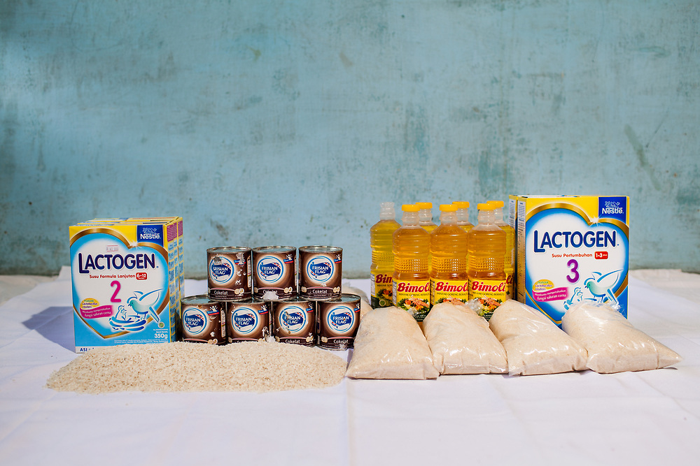 Food packages given by YPKM, which includes 2kg of rice, cooking oil, sugar, milk, and infant formula (costing approx. $25), to those who are in the late stages of AIDS and mothers who cannot breastfeed their infants.  The health condition of almost every person receiving this monthly food package has greatly improved.<br />