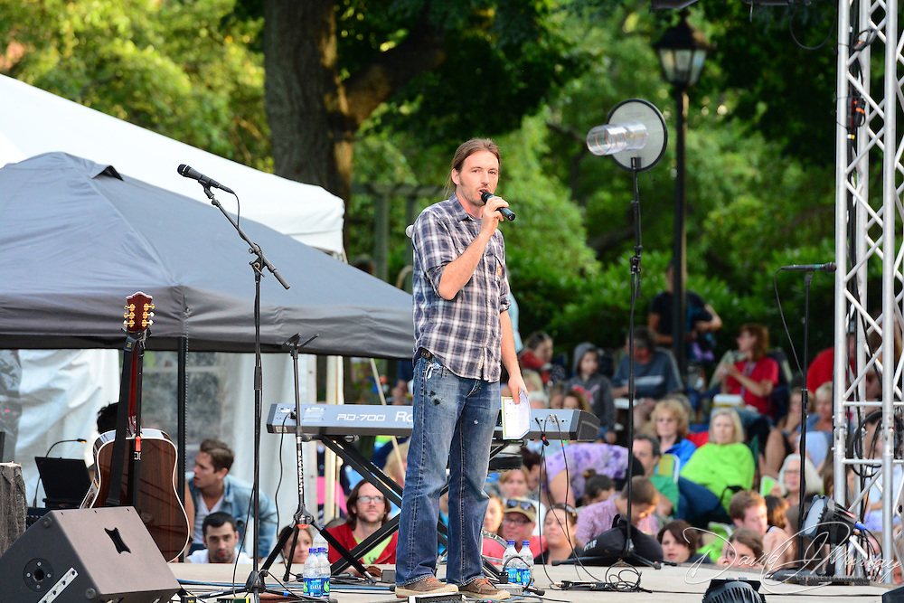 Prescott Park Arts Festival Executive Director Ben Anderson introduces a concert by The Head and the Heart in July, 2013,