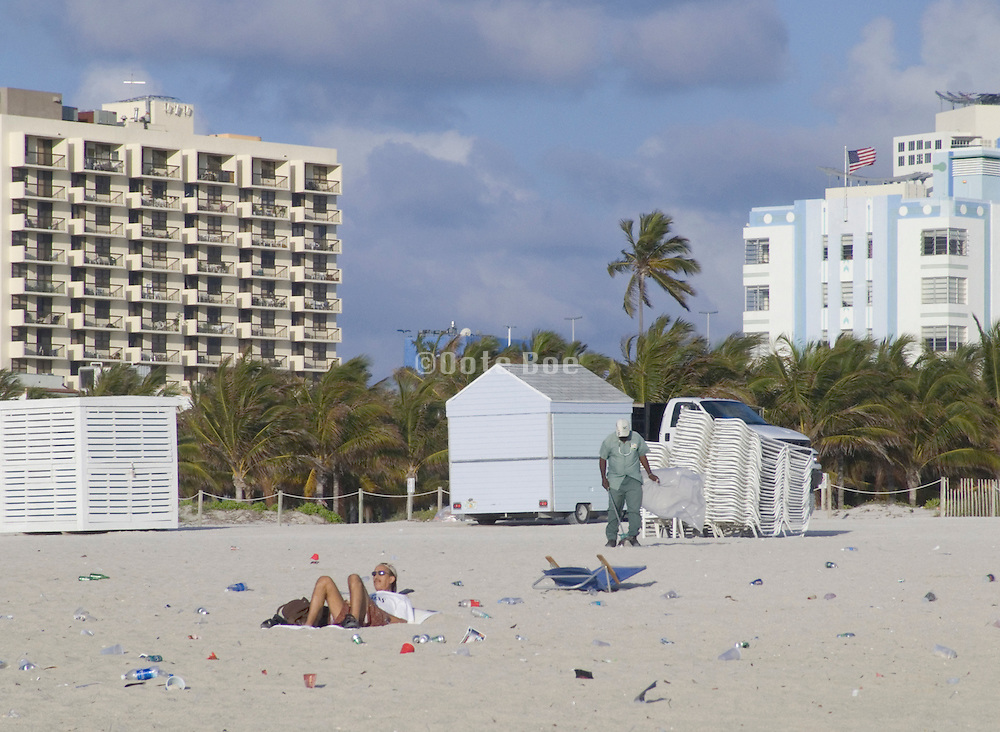 early morning cleaners cleaning up the beach Miami USA