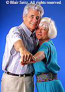 Active Aging Senior Citizens, Retired, Activities, Man and Woman with White Hair, Elderly Couple Romance, Couple Playful, Informal Portrait