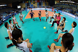 Team Japan players warm up before the match with Puerto Rico