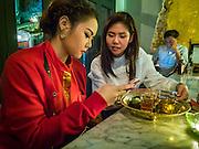 27 JANUARY 2016 - BANGKOK, THAILAND: Women at the bar in Tep Bar, a new bar and restaurant in the Chinatown neighborhood of Bangkok.       PHOTO BY JACK KURTZ