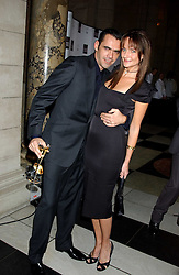 Designer ROLAND MOURET and model SAFFRON ALDRIDGE at the 2005 British Fashion Awards held at The V&A museum, London on 10th November 2005.<br />