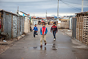 Teenagers at Konik Camp located in the suburbs of the city of Podgorica, Montenegro. A huge fire in 2012 detroyed a big part of the refugee camp and many of the inhabitants are living in containers. The housing pictured belongs to the part with new and old housing facilities.