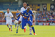 AFC Wimbledon striker Tom Elliott (9) and Bolton Wanderers midfielder Liam Clayton (17) tussle during the EFL Sky Bet League 1 match between AFC Wimbledon and Bolton Wanderers at the Cherry Red Records Stadium, Kingston, England on 13 August 2016. Photo by Stuart Butcher.