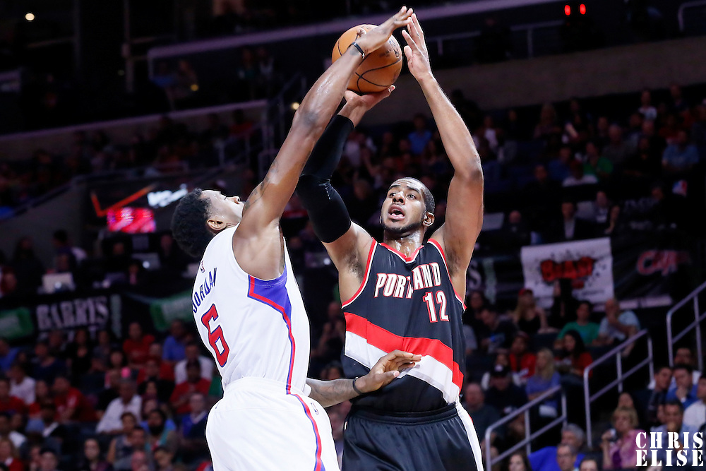 08 November 2014: Los Angeles Clippers center DeAndre Jordan (6) blocks Portland Trail Blazers forward LaMarcus Aldridge (12) during the Los Angeles Clippers 106-102 victory over the Portland Trail Blazers, at the Staples Center, Los Angeles, California, USA.