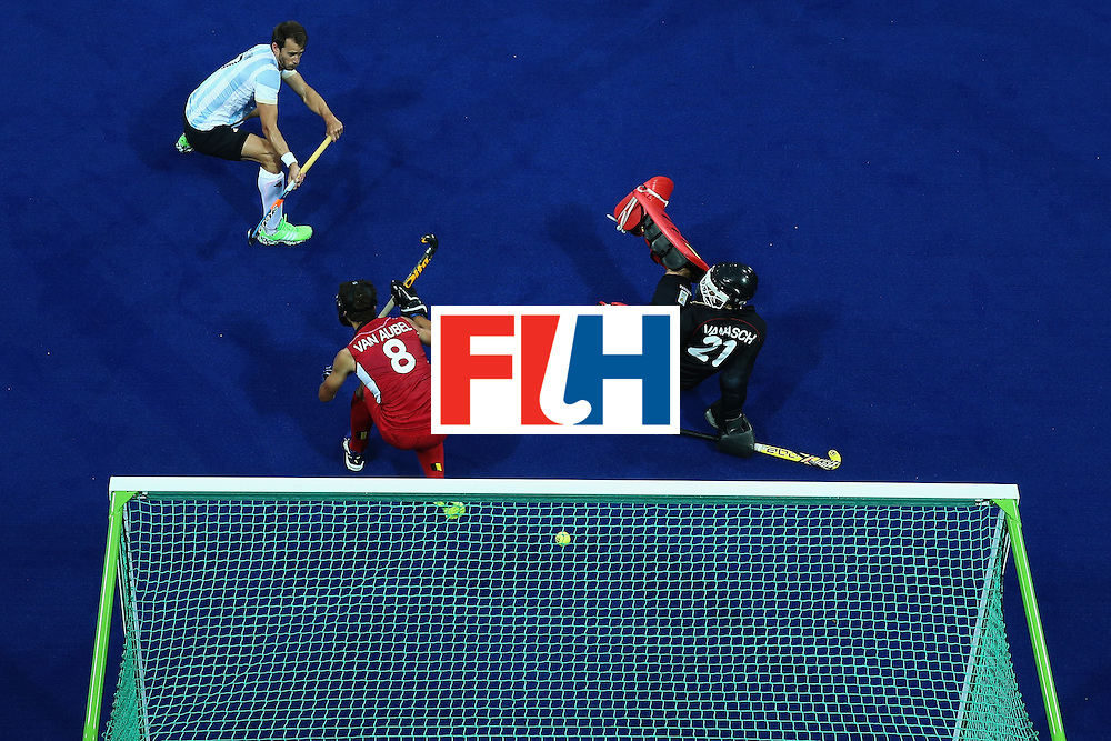 RIO DE JANEIRO, BRAZIL - AUGUST 18:  Facundo Callioni #7 of Argentina watches a shot on goal defended by Florent van Aubel #8 and Vincent Vanasch #21 of Belgium during the Men's Hockey Gold medal match at the Olympic Hockey Centre on Day 13 of the 2016 Rio Olympic Games on August 18, 2016 in Rio de Janeiro, Brazil.  (Photo by Sean M. Haffey/Getty Images)