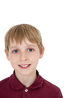 Close-up portrait of happy blond boy over white background