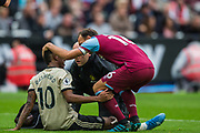 Marcus Rashford (Man United) injured and being assessed with support from Mark Noble (Capt) (West Ham) during the Premier League match between West Ham United and Manchester United at the London Stadium, London, England on 22 September 2019.