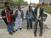 Cory Booker talks with students at Quitman Street Community School on his first day as the Mayor of Newark on May 10, 2006.