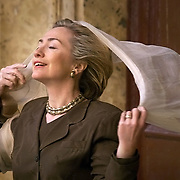 First Lady Hillary Rodham Clinton puts a veil on before entering a mosque in Cairo, Egypt...Photo by Khue Bui