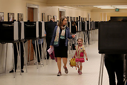 Nov. 8, 2016 - San Francisco, California, U.S. - A voter comes to cast her vote with her child at a polling station in the City Hall of San Francisco. The U.S. presidential elections kicked off on Tuesday. (Credit Image: © Liu Yilin/Xinhua via ZUMA Wire)