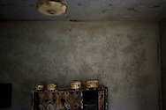 SYRIA, Idlib province: Pots and pans lie burnt a few days after troops of the Al Assad regime entered  the village to destroy and burn houses of allegedly pro revolution activists on April 11, 2012. ALESSIO ROMENZI