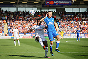 Peterborough United midfielder George Cooper (19) on the ball during the EFL Sky Bet League 1 match between Peterborough United and Luton Town at London Road, Peterborough, England on 18 August 2018.