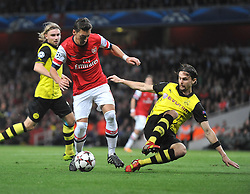 Borrusia Dortmund's Neven Subotic tackles Arsenal's Mesut Ozil inside the box - Photo mandatory by-line: Alex James/JMP - Tel: Mobile: 07966 386802 22/10/2013 - SPORT - FOOTBALL - Emirates Stadium - London - Arsenal v Borussia Dortmund - CHAMPIONS LEAGUE - GROUP F