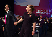 © Licensed to London News Pictures. 02/10/2012. Manchester, UK Ed Miliband laughs after kissing his wife Justine, Labour Party leader finishes making his leaders speech on Day 3 at The Labour Party Conference at Manchester Central today 2nd october 2012. Photo credit : Stephen Simpson/LNP