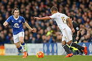 Everton defender Leighton Barnes  tries to close down Swansea City midfielder Wayne Routledge  during the Barclays Premier League match between Everton and Swansea City at Goodison Park, Liverpool, England on 24 January 2016. Photo by Simon Davies.