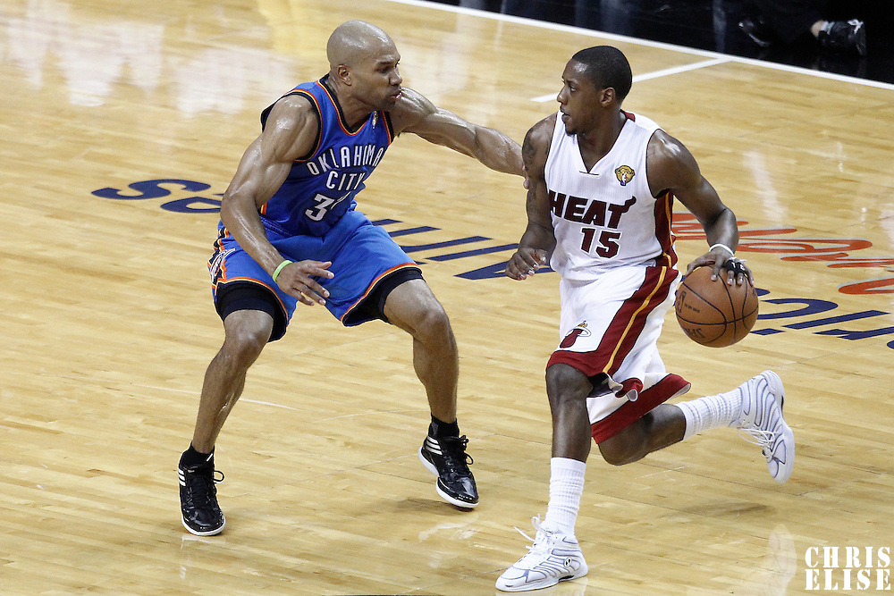 17 June 2012: Oklahoma City Thunder point guard Derek Fisher (37) defends on Miami Heat point guard Mario Chalmers (15) during the Miami Heat 91-85 victory over the Oklahoma City Thunder, in Game 3 of the 2012 NBA Finals, at the AmericanAirlinesArena, Miami, Florida, USA.