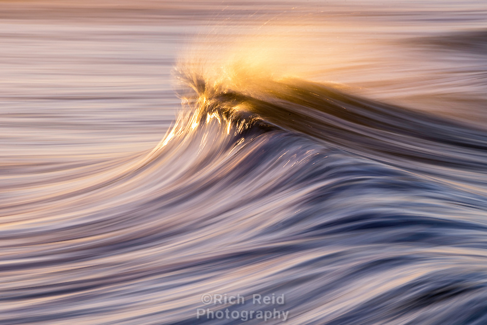 Sunrise on a wave panning at 1/3rd of a second on San Buenaventura Beach at high tide in Ventura, California on December 29, 2016.