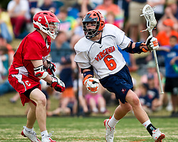 Virginia Cavaliers A Steele Stanwick (6) in action against Cornell. The #1 ranked Virginia Cavaliers defeated the #4 ranked Cornell Big Red 14-10 at Klockner Stadium on the Grounds of the University of Virginia in Charlottesville, VA on March 8, 2009.