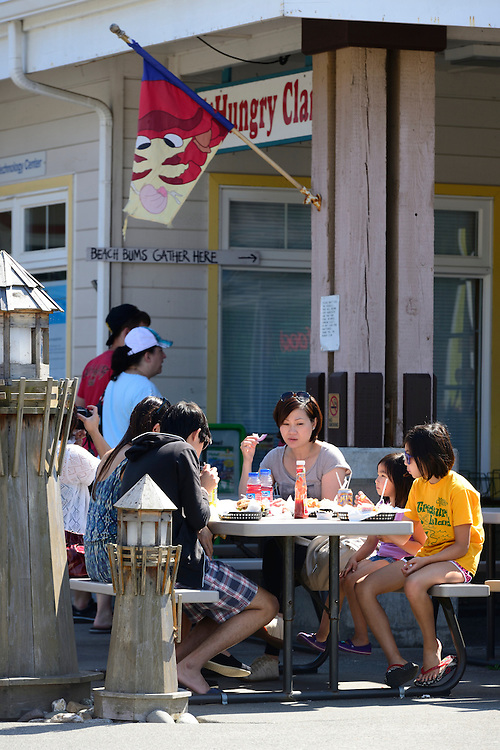 Chinese Family at Brookings Harbor, Brookings, Oregon, USA<br /> Model release 0258