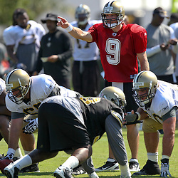 July 31, 2011; Metairie, LA, USA; New Orleans Saints quarterback Drew Brees (9) under center during training camp practice at the New Orleans Saints practice facility. Mandatory Credit: Derick E. Hingle
