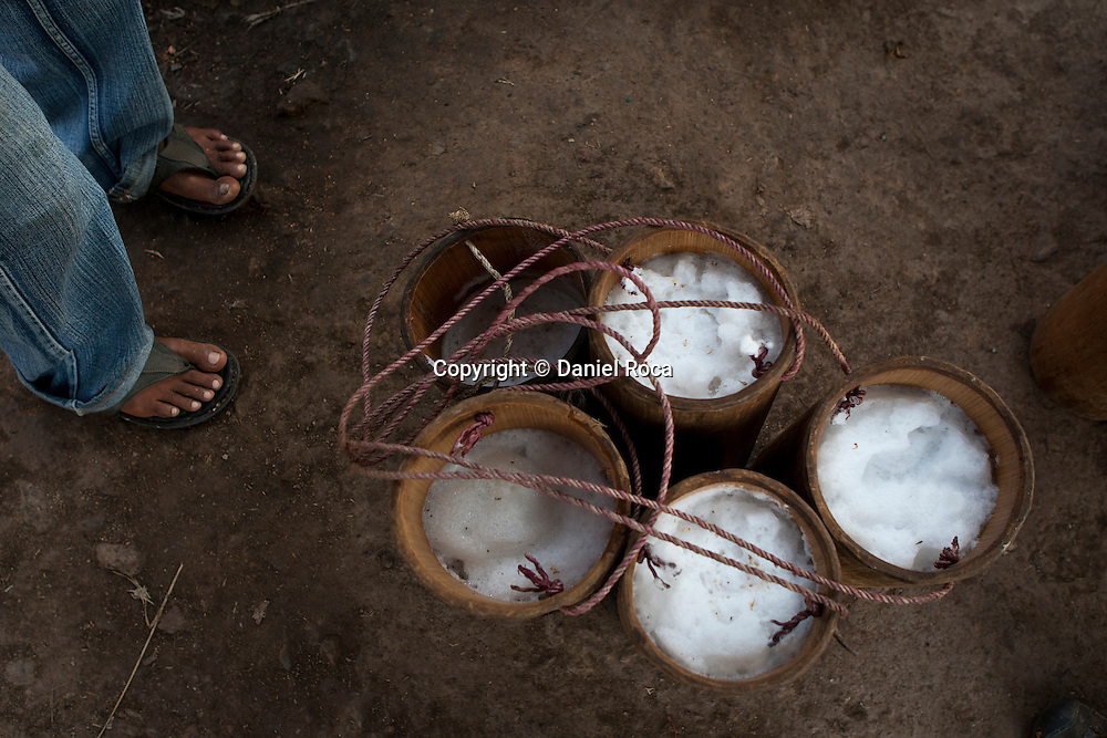 Containers full of freshly harvested sap from the palm trees. At Ka Myaw Gyi village in the outskirts of Dawei, Myanmar.