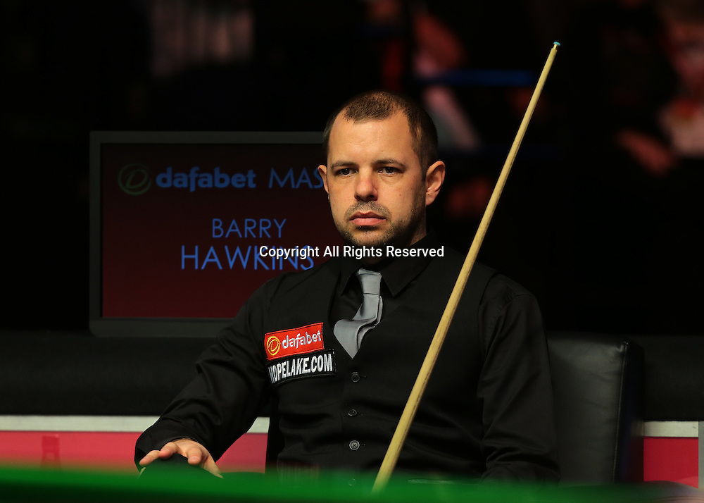 16.01.2016.  Alexandra Palace, London, England. Masters Snooker. Semi Finals. Barry Hawkins watches on as Judd Trump wins frame three