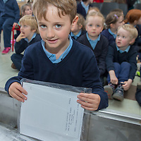 Conor O'Brien from Junior Infants puts something into the time capsule