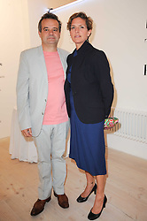 MARK HIX and ANNA DRUMMOND at a dinner hosted by Harper's Bazaar to celebrate Browns 40th Anniversary in aid of Women International held at The Regent Penthouses & Lofts, 16-18 Marshall Street, London on 20th May 2010.