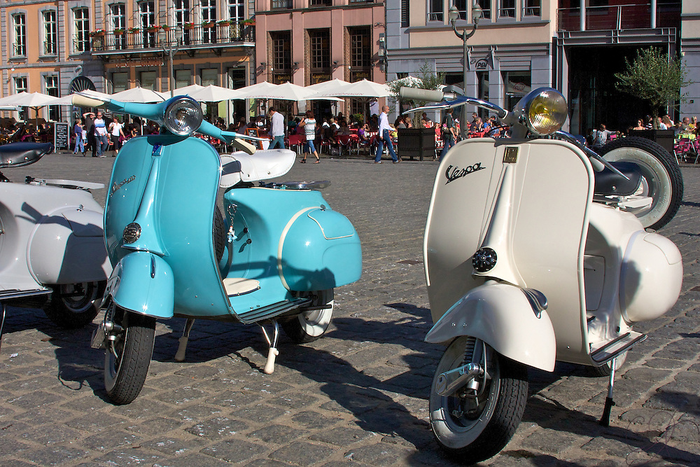 Classic Vespa scooters on a summer afternoon