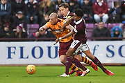 Curtis Main under pressure from Christophe Berra and Demetri Mitchell during the Ladbrokes Scottish Premiership match between Heart of Midlothian and Motherwell at Tynecastle Stadium, Gorgie, Scotland on 27 January 2018. Photo by Kevin Murray.