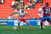 Doncaster Rovers Midfielder James Coppinger (26) during the The FA Cup match between Doncaster Rovers and Scunthorpe United at the Keepmoat Stadium, Doncaster, England on 3 December 2017. Photo by Craig Zadoroznyj.