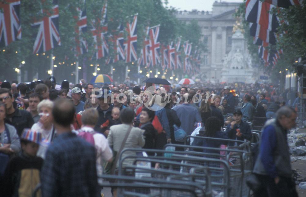 Queen Elizabeth II Golden Jubilee weekend; June 2002; Crowds in The Mall; central London celebrating