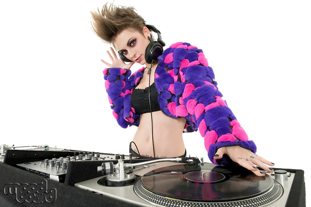 Portrait of beautiful DJ over white background