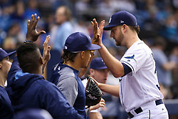 May 9, 2017 - St. Petersburg, Florida, U.S. - WILL VRAGOVIC   |   Times.Tampa Bay Rays starting pitcher Matt Andriese (35) welcomed into the dugout after getting out of the top of the fourth inning  of the game between the Kansas City Royals and the Tampa Bay Rays at Tropicana Field in St. Petersburg, Fla. on Tuesday, May 9, 2017. (Credit Image: © Will Vragovic/Tampa Bay Times via ZUMA Wire)