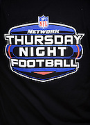 A sideline cameraman wears a shirt with the NFL Network Thursday Night Football logo on it during the Philadelphia Eagles NFL week 3 football game against the Kansas City Chiefs on Thursday, Sept. 19, 2013 in Philadelphia. The Chiefs won the game 26-16. ©Paul Anthony Spinelli