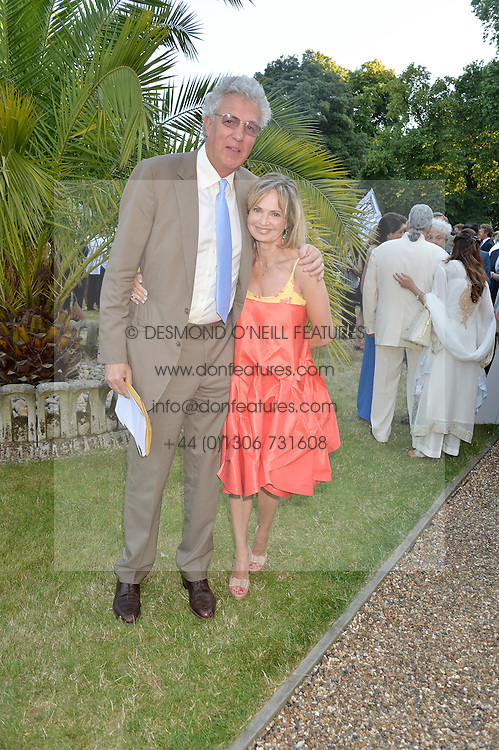 HENRY WYNDHAM and COUNTESS MAYA VON SCHOENBURG at the Quintessentially Foundation and Elephant Family 's 'Travels to My Elephant' Royal Rickshaw Auction presented by Selfridges and hosted by HRH The Prince of Wales and The Duchess of Cornwall held at Lancaster House, Cleveland Row, St.James's, London on 30th June 2015.