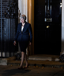 © Licensed to London News Pictures. 14/11/2018. London, UK. British Prime Minister THERESA MAY leaves 10 Downing Street to make a statement after presenting a Brexit deal to Cabinet. Photo credit: Ben Cawthra/LNP