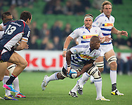 Siyamthanda Kolisi (Stormers) passes the ball during the Round 14 match of the 2013 Super Rugby Championship between RaboDirect Rebels vs DHL Stormers at AAMI Park, Melbourne, Victoria, Australia. 17/05/0213. Photo By Lucas Wroe