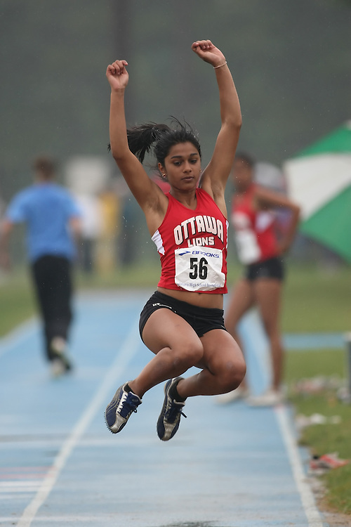 "(Ottawa, Ontario---20080628) ""Biswal, Devyani"" competing in the long jump at the 2008 District G qualifier for the Royal Canadian Legion Ontario Track and Field Championships. This image is copyright Sean W. Burges, and the photographer can be contacted at seanburges@yahoo.com."