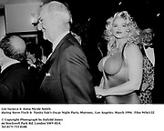 Lee Iacocca & Anna Nicole Smith <br />during Steve Tisch &  Vanity Fair's Oscar Night Party,<br />Mortons,  Los Angeles. March 1994.  Film 94563/22<br /> <br />© Copyright Photograph by Dafydd Jones<br />66 Stockwell Park Rd. London SW9 0DA<br />Tel 0171 733 0108.